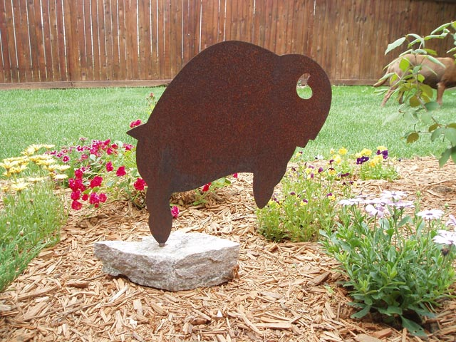 Metal buffalo sculpture.